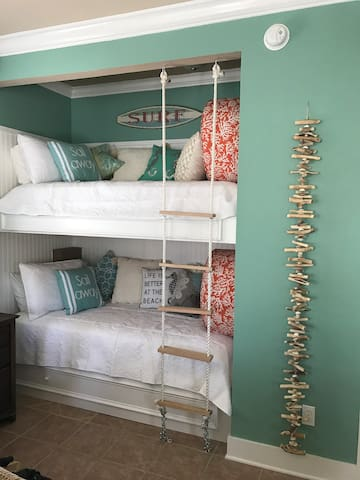 Built-in bunk beds in the living room with high quality mattresses