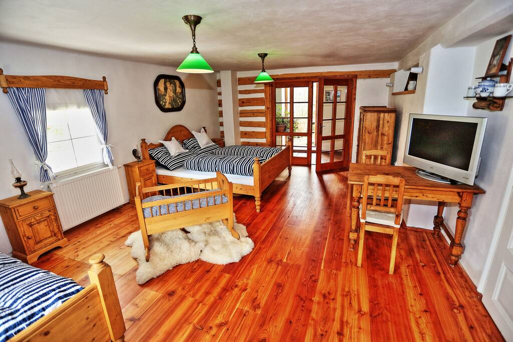 Timbered bedroom provides a splendid view to the mill wheel and the private patio.