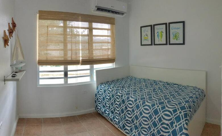 Two twin size beds with AC and an ample closet