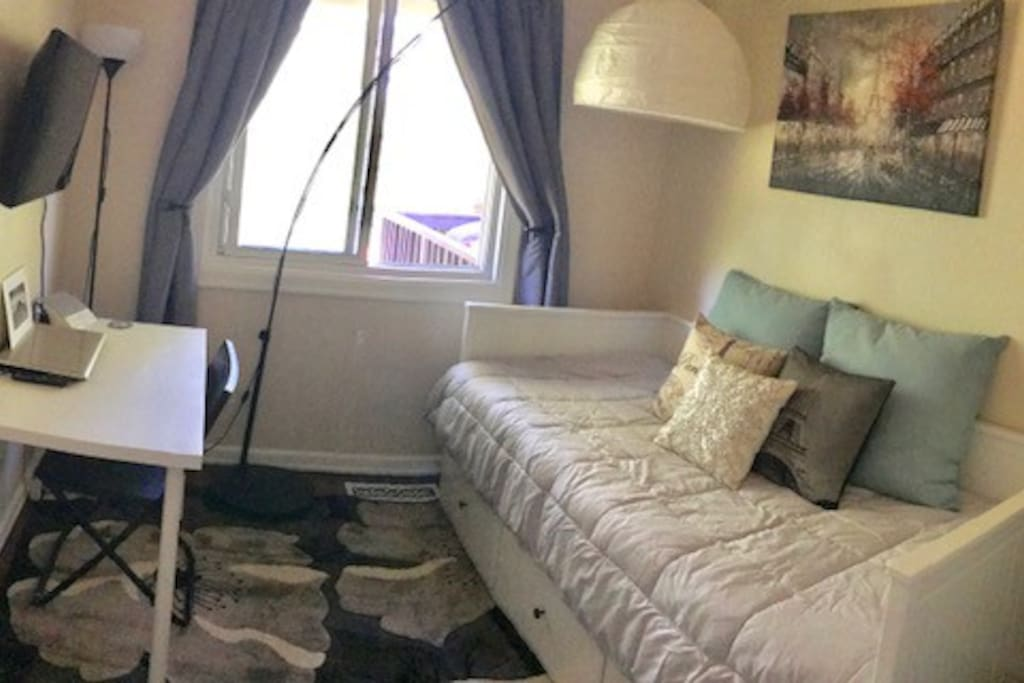 The room offers a full closet, twin size bed that opens up to a king, and has 3 large drawers built under it, a smart tv, and a small desk.  There is also a California Closet to store clothes and travel items.