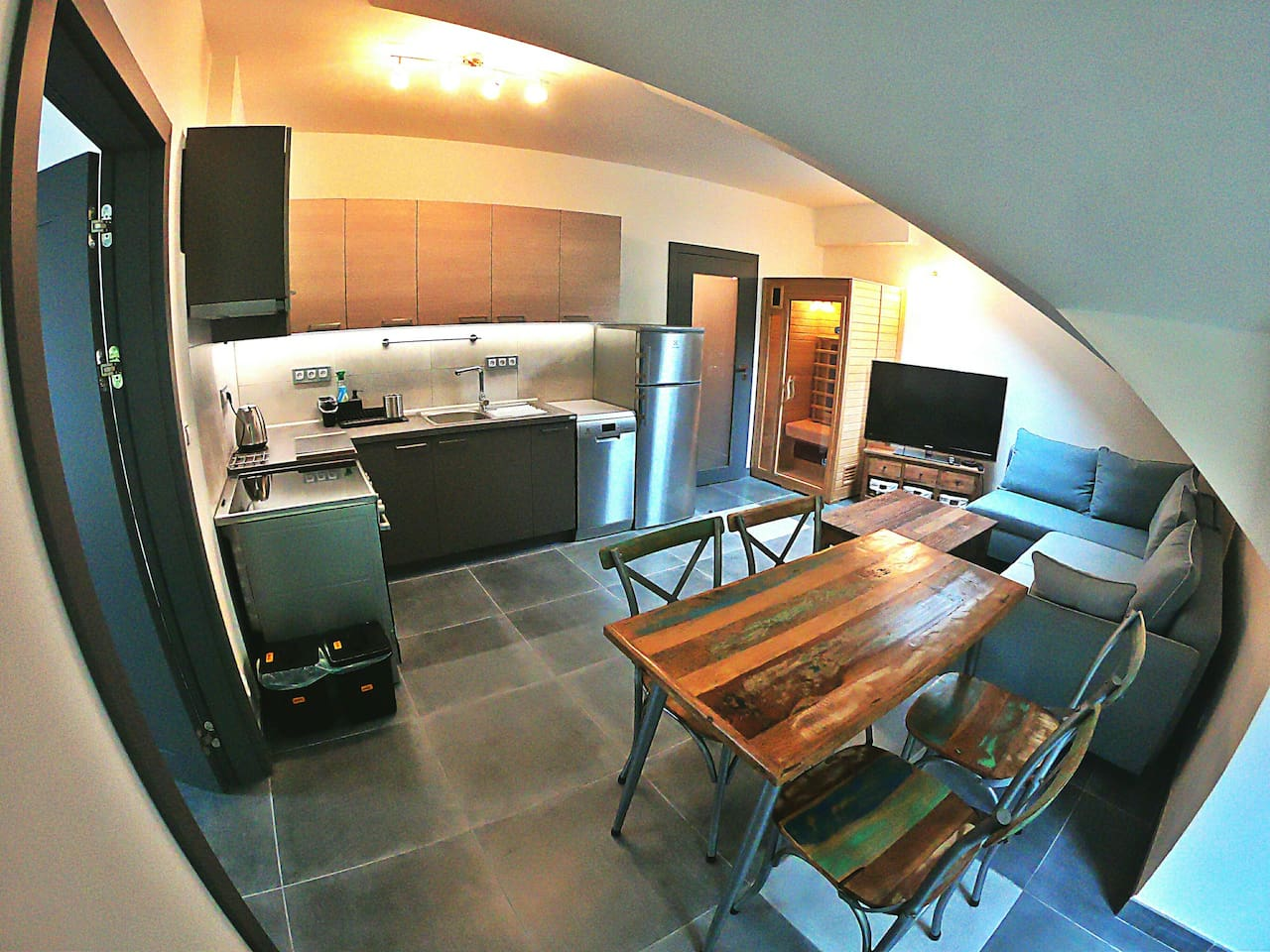 Fully equipped kitchen, dining area, and living space.