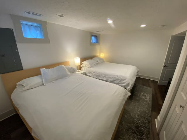 Oversized double bedroom.  Featuring two queen beds.    Large closet, dresser, and brand new smart LCD TV!  (Sleeps 4)