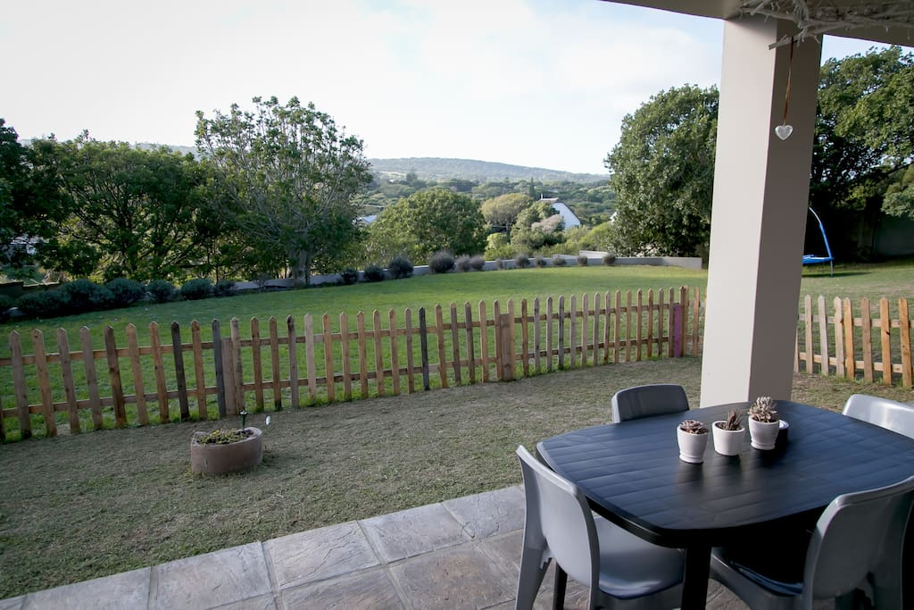 Stunning patio with the most amazing view. It's quiet and private and includes a table for you to sit and enjoy your meals, sundowners etc. It also has a braai, if you'd like to cook your food, the South African way ;)