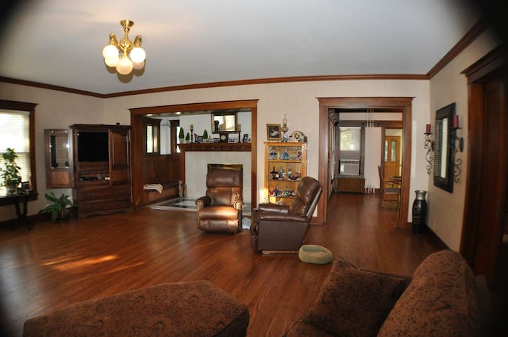 We are the 5th family to own this historical home. We purchased it in February, 2015. One of our projects was to remove carpet and refinish 2500 sq. ft. of hard wood floors. This beautiful oak floor is in the living room. This room is very spacious, yet comfortable. It easily seats 6 to 8 people; more if we bring chairs in. It opens to the fireplace room.