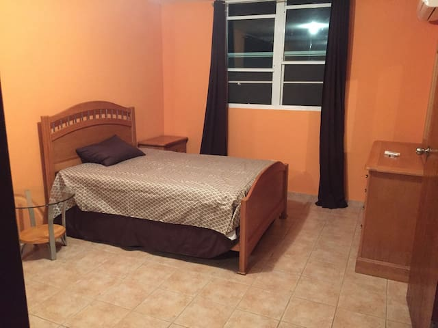 Spacious master room with full size bed and A/C. Private bathroom and walk-in closet