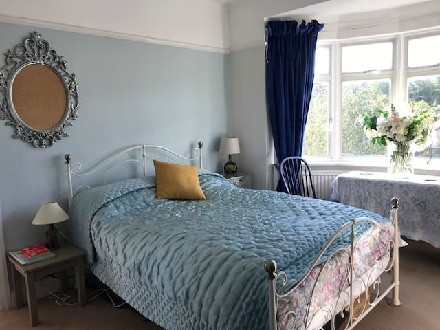 Sunny double room in comfortable cheery house.