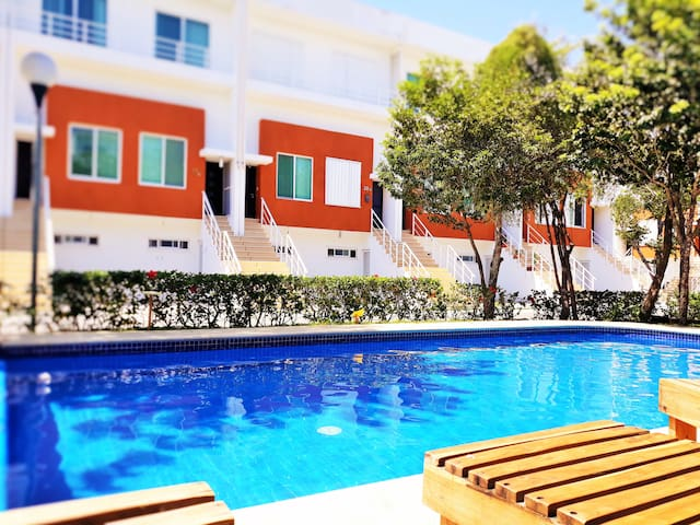 Cozy Room w/ balcony view to the pool