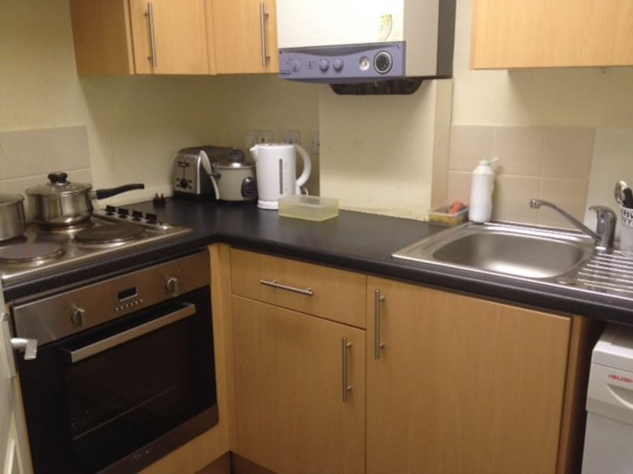 Fully furnished kitchen with oven, hob, microwave, toaster, kettle, fridge/freezer, utensils etc.