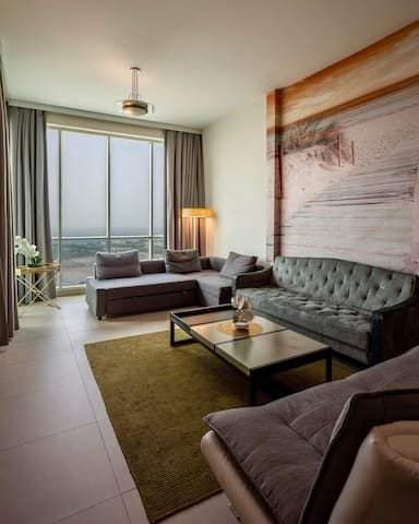 Beautifully designed living room with beautiful views of Al Sufouh public beach, Burj Al Arab, Atlantis hotel from every corner of the house making your stay memorable. It has 2 large sofa beds good for 4 people to sleep