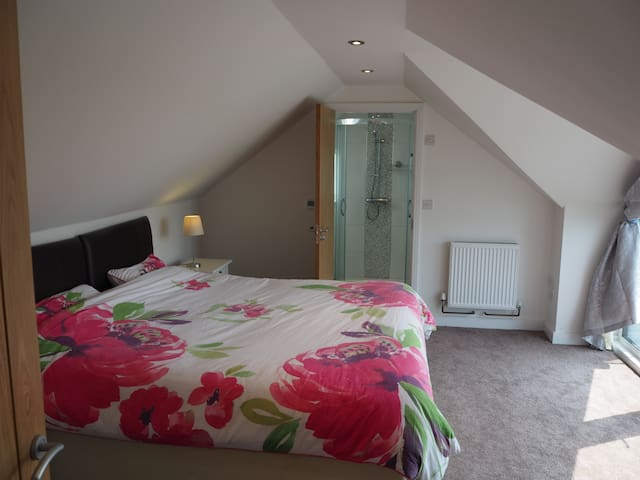 Bedroom 2, super King sized double or 2 twin beds. En-suit with shower and balcony with distant sea views.