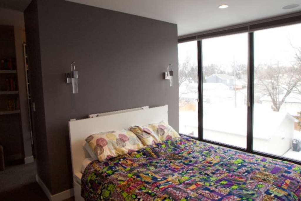 Queen size bed in 3rd floor master bedroom, floor to ceiling windows with blackout blinds