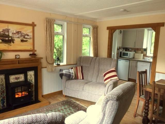 Here, you can sit and enjoy the comforts of the lounge/dining area in front of the Log Burner effect fire. Snuggle up in one of the reclining armchairs with a good book, or plan your next adventure on Dartmoor. There's lots to do and see!