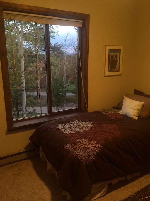 Bed next to window with North West views of nature