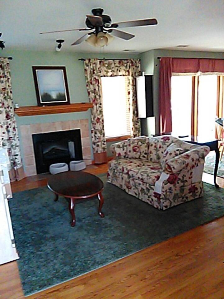Main floor area designated for guest (s) with TV and relaxing fireplace.