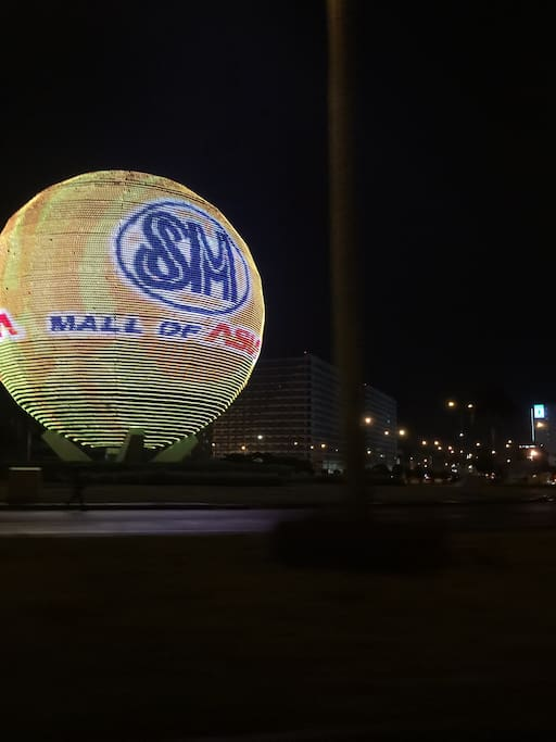 View in front of Shell Residences. The globe serves as an electronic board of the Mall of Asia(MOA). This is a round about (rotunda) and a well known landmark in Manila.