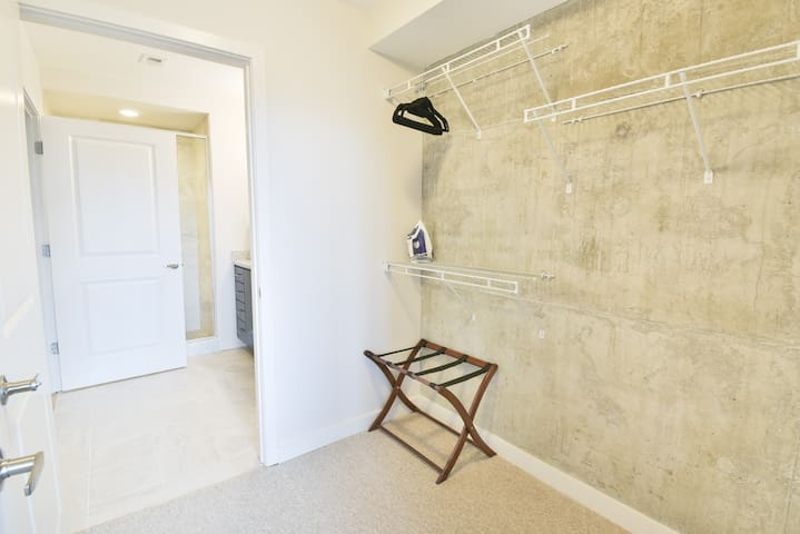 closet space with luggage rack