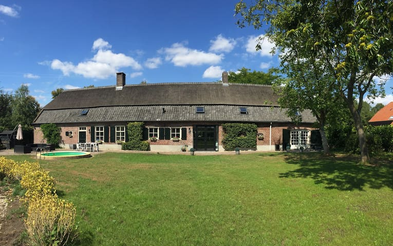 The back of our house. The studio is located on the far right and has its own entrance with the double glass doors
