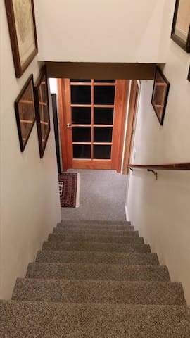 this room is at the bottom of these stairs. The windows on your door are pretty, but will be blocked off for privacy.