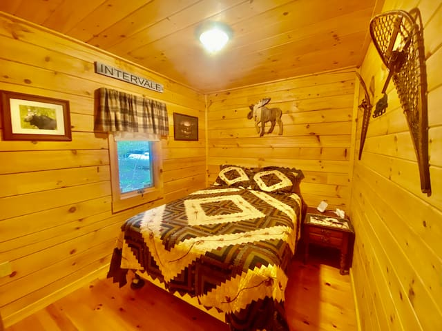 Our bedroom for guests has  queen bed with a Sterns & Foster mattress, a sound machine, closet, nighstand, along with cabin decor and artwork from local artists in Maine and New Hampshire.