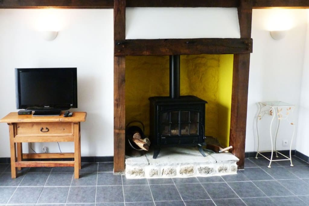 Bright front room with a cosy wood burner