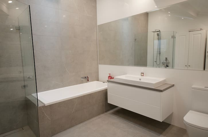 Family bathroom with deep bath, separate shower and toilet