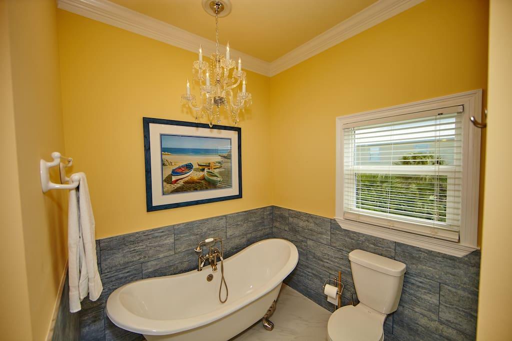 Bear Claw tub and Chandelier in Master Bathroom