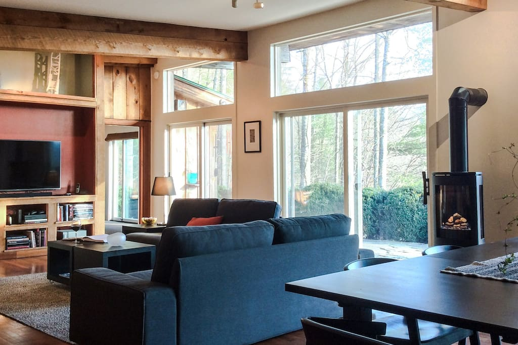 The wooden beams, raw wood details, and new gas log stove add ambiance and make for a very relaxing space so you can also take in the amazing view.