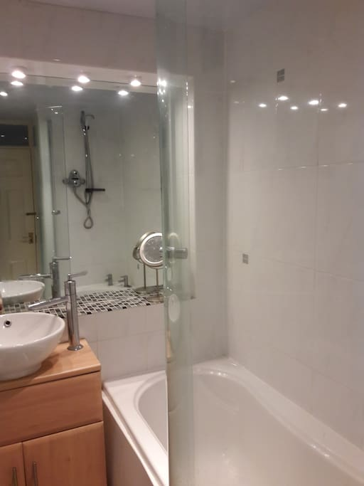 Bright bathroom with separate toilet next door