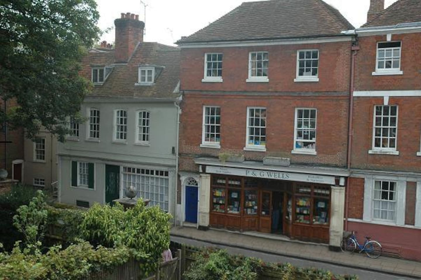 The flat is on the top floor above a bookshop in a quiet street