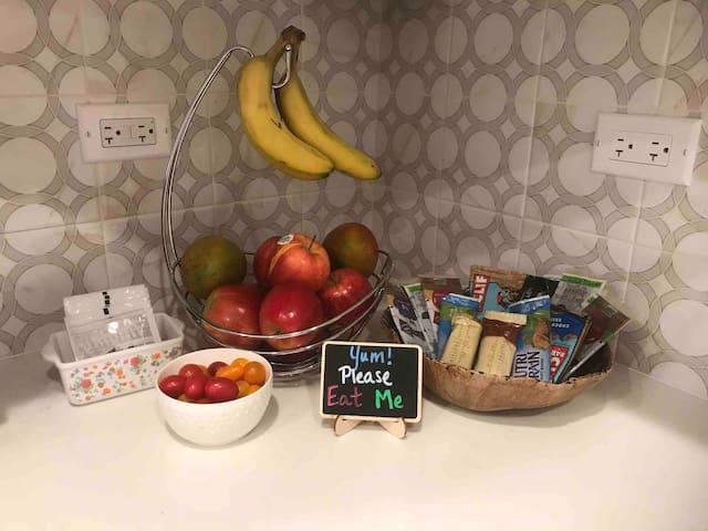 Guest snack bar in the kitchen. Help yourself to fresh fruit, protein bars, and tea/coffee.