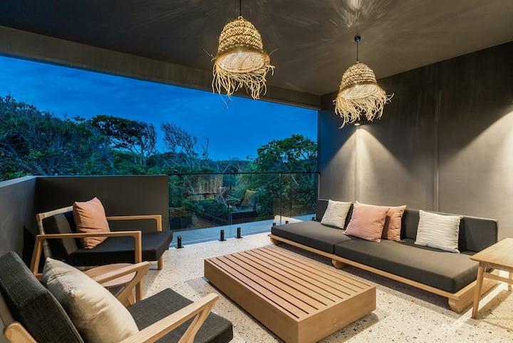 Luxury beachfront suite with ocean glimpses