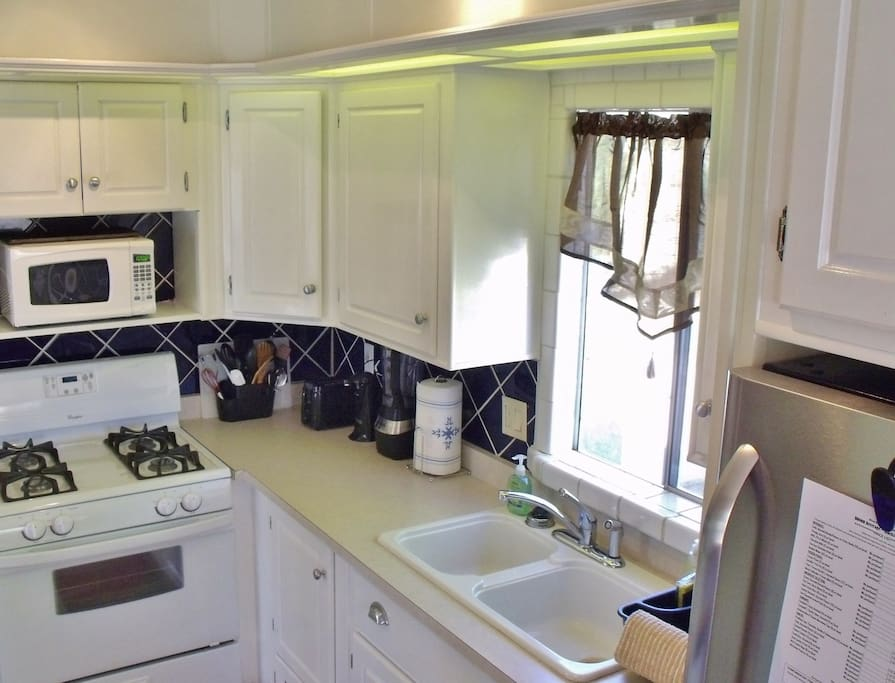 A fully equipped kitchen awaits you.