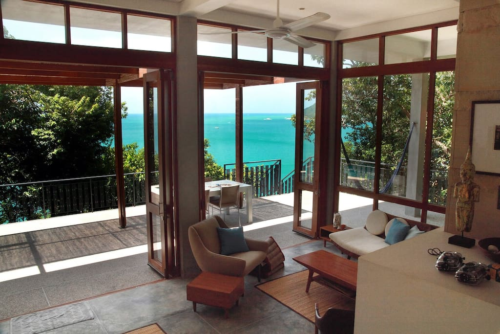 View from entry across living room and deck out to sea.