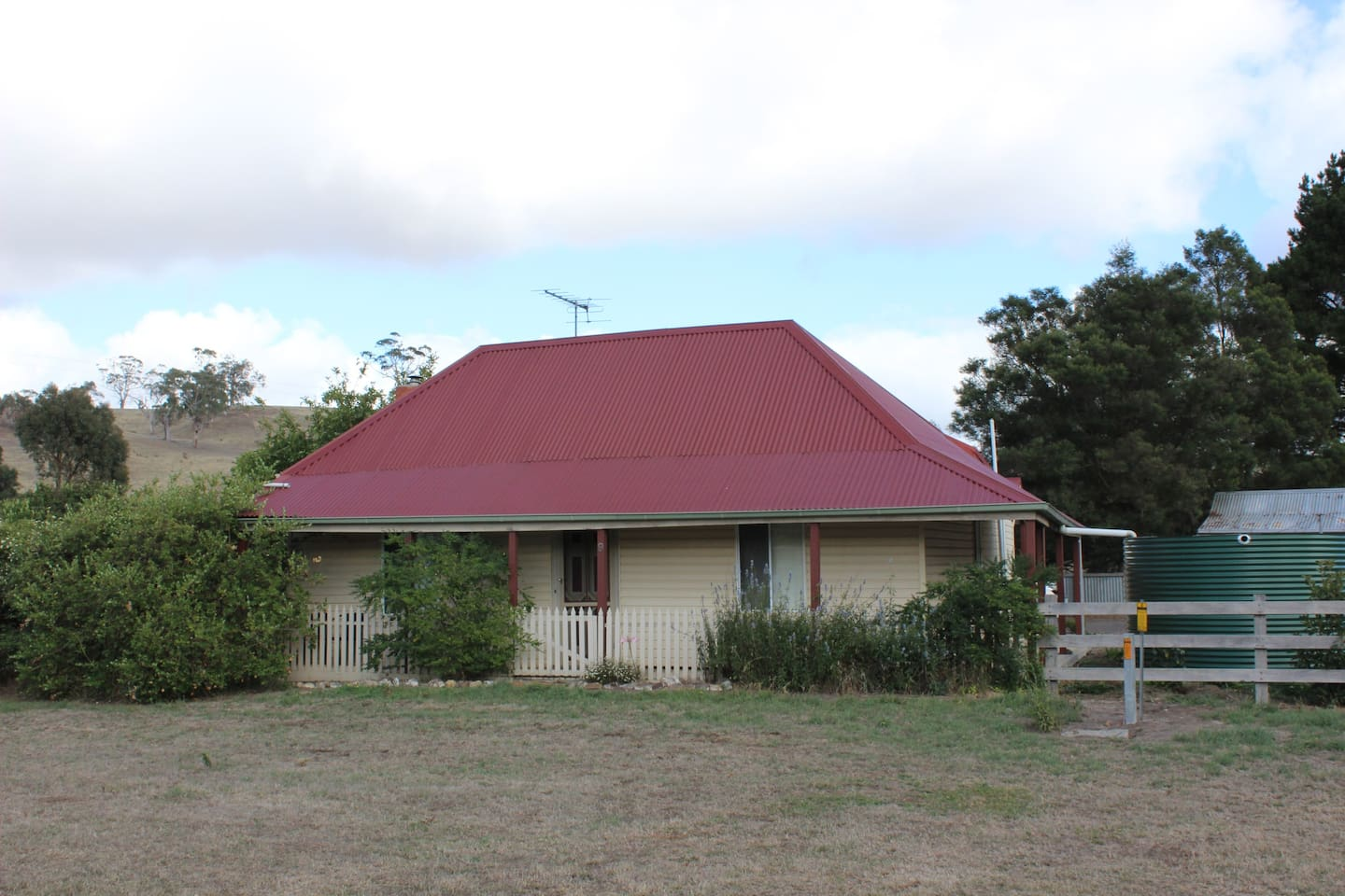 Front of house, has small covered verandah.