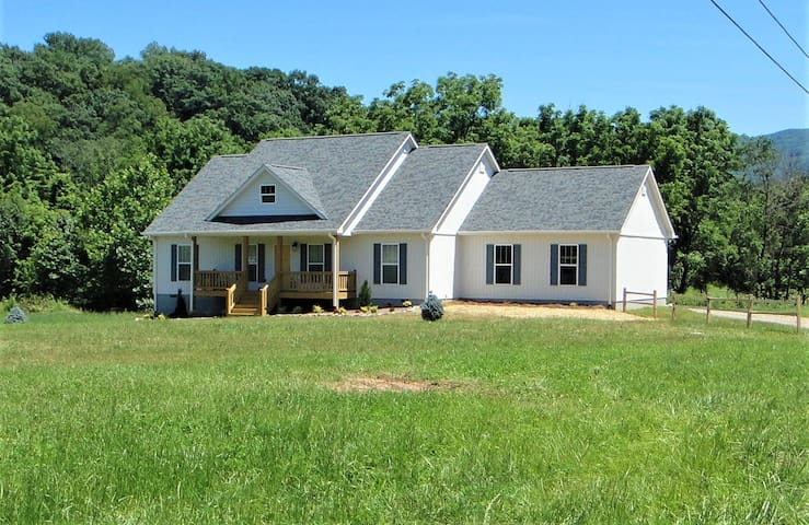 Farm House, Your home away from home in Waynesville NC. Visit the Western North Carolina Mountains from this brand-new home near downtown Waynesville. Make this your base camp as you visit all the wonderful attractions this mountain region offers.