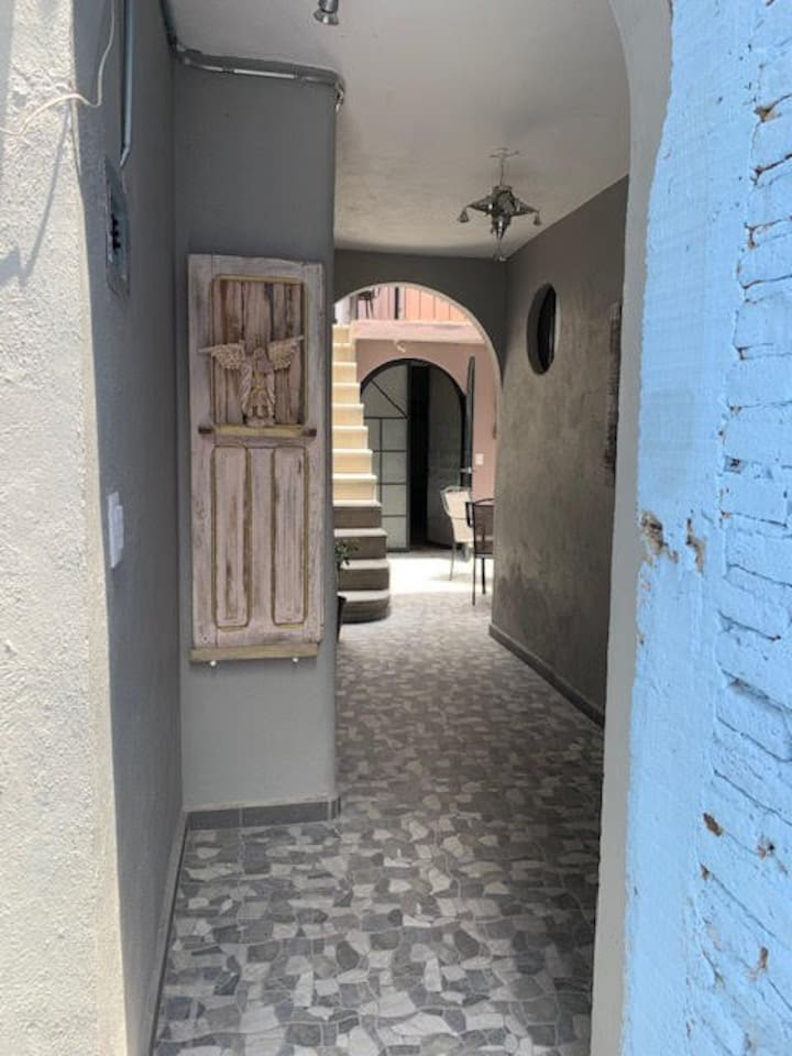 Hallway to patio and apartment.