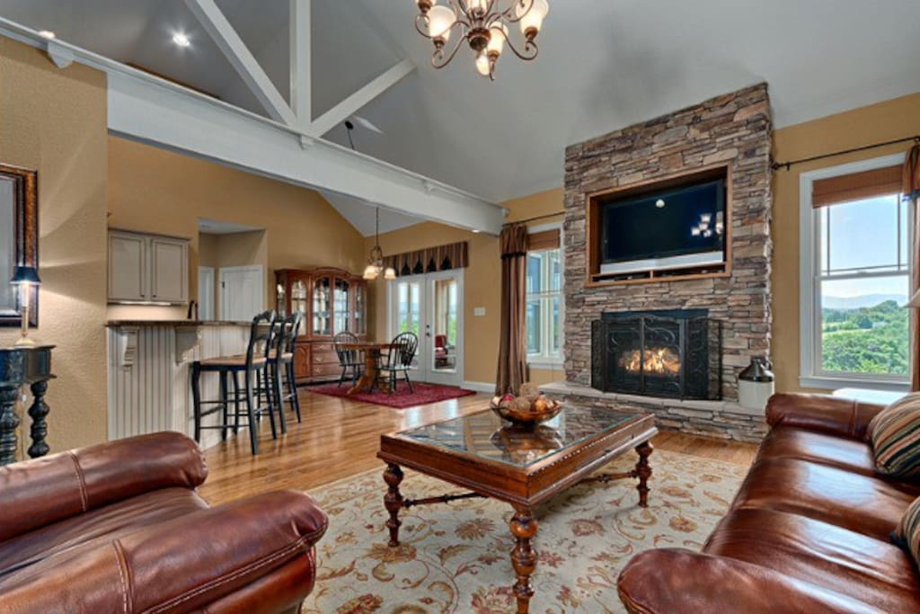 Cozy living room with vaulted ceilings, gas fireplace and amazing views.