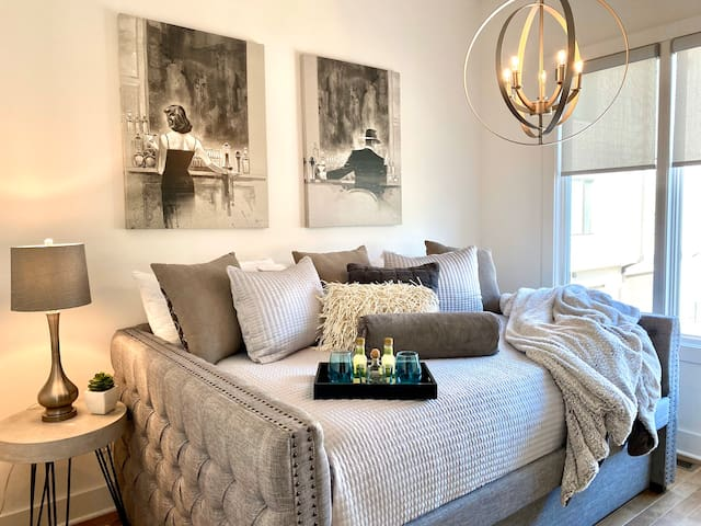 Gorgeous guest bedroom located off of the kitchen/dining space. Luxurious trundle bed with attached bathroom