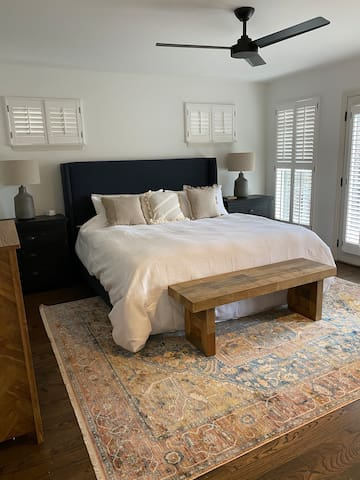 Bedroom 1 - Master with King bed. French doors open up to top deck.