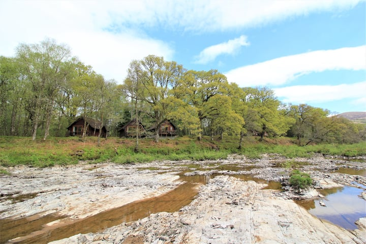 Wooden lodge with unbroken River Spean views
