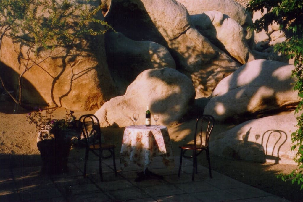 There are five terraces surrounding the park. A stone fire pit is by the boulders.