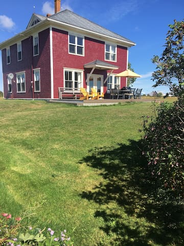 Oceanfront farmhouse on acres of privacy.