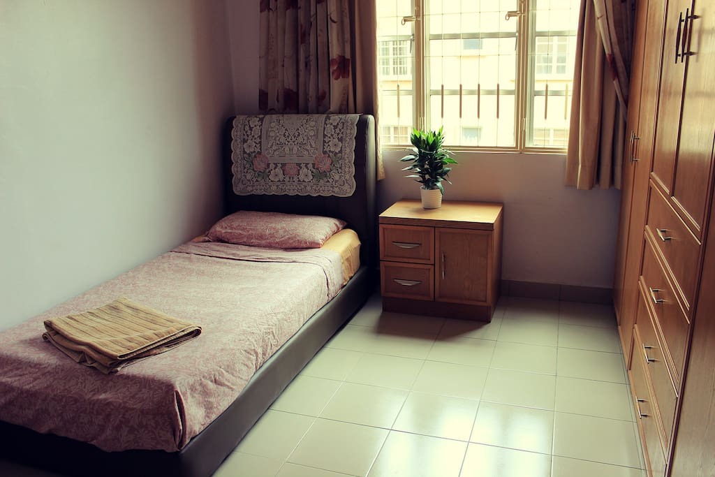 Bedroom with true bed for one person, aircon and fan
