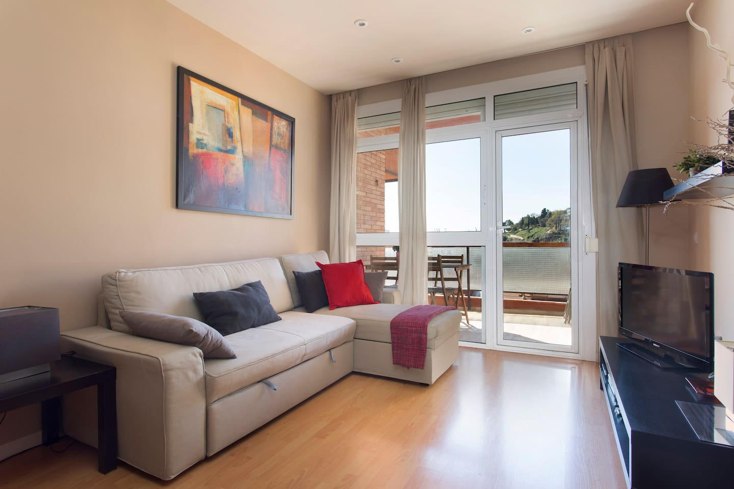 Comfortable and sunny living room. Views to sea and Montjuich