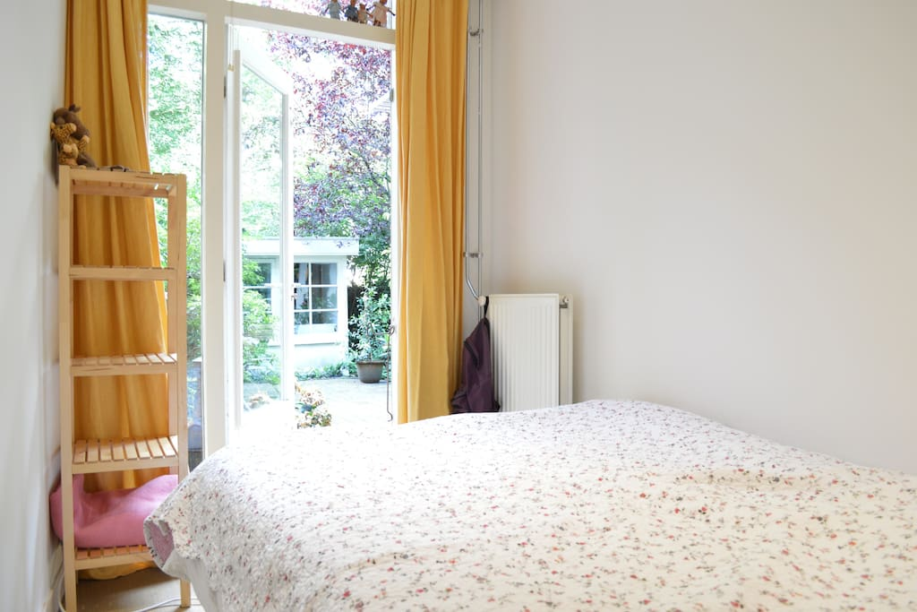 The bedroom has direct access to the beautiful garden