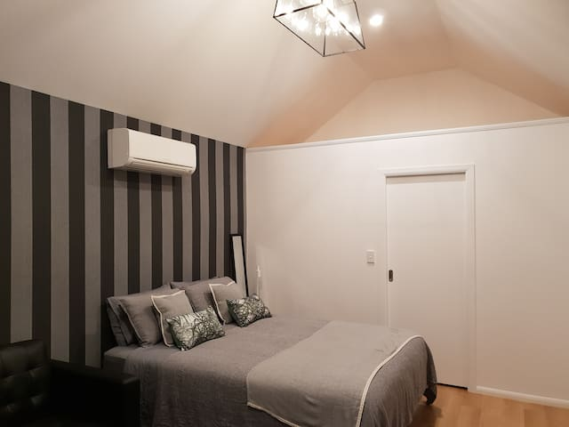 Queen bed with quality linen and heat pump/air conditioning