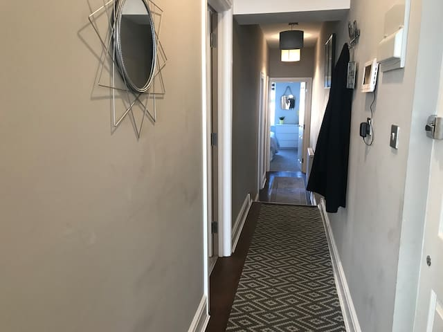 Long spacious hallway with all rooms leading off