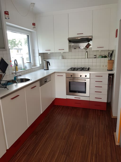 Fully equipped  kitchen with fridge, freezer, gas stove and electric oven
