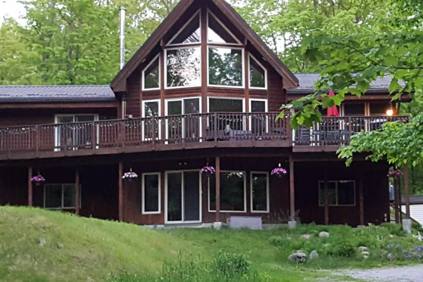 Summer is great!  Enjoy the summer months in our beautiful post and beam.  Loaded with hot tub, sauna, whirlpool tub and many games.  The indoors and outdoors are breathtaking.