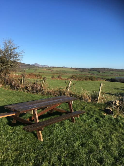 It's not fenced off but you'll have access to a grassy area with stunning views.